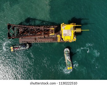 Heavy lift cargo ship transporting a rig in the sea.