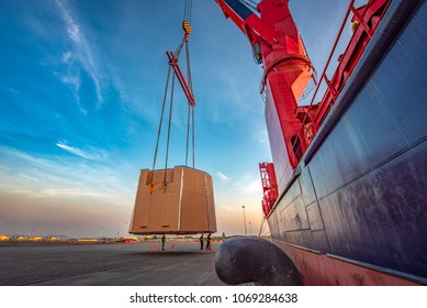 heavy lift packages cargo shipment lifting by the jumbo ship crane for delivery and transport to destination by sea and lands logistics services