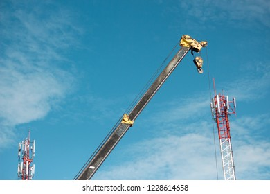 Heavy lifting cranes at heavy construction sites.