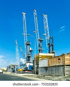 Heavy load dockside cranes in port, cargo yard, Industrial scene, Business and commerce.