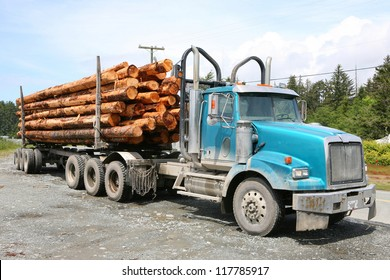 heavy loaded logging truck parking next to a coastal road on Vancouver Island, Canada