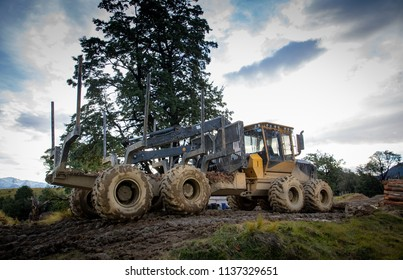 Heavy logging machinery at work on a logging site