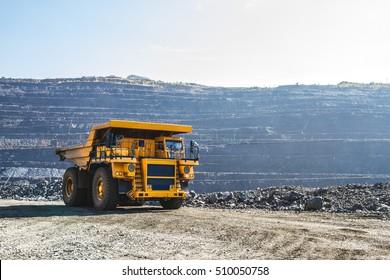 Heavy machinery, quarry, iron ore, ore extraction.