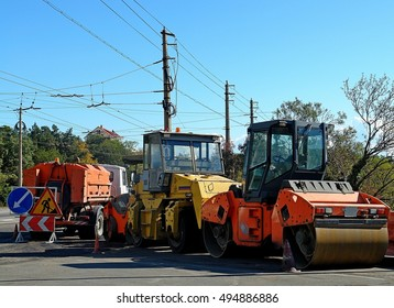 heavy machinery of the three machines for the repair of roads located on the side of the road