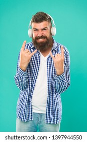 Heavy metal and hard rock. Streaming music sites. Wireless technology. Hipster with beard listening music. Handsome music lover. Man in headphones. User friendly interface and large library of tunes.