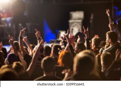 Heavy metal music fans rising hands in the air