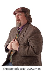 Heavy middle-aged man with goatee, cap and tweed jacket has hands gripping lapels. Horizontal, isolated on white, copy space.