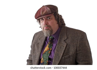 Heavy middle-aged man with goatee, cap and tweed jacket with thoughtful expression. Horizontal, isolated on white, copy space.
