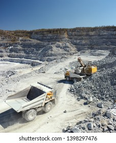 Heavy mining machinery in a stone quarry, panorama.
