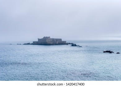 A heavy mist moves towards St Malo, partially obscuring the ancient Fort National on its island