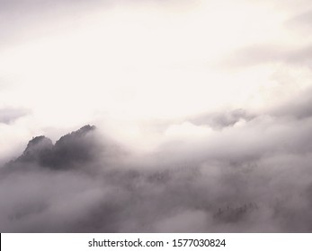 Heavy misty daybreak. Misty daybreak in a beautiful hills. Peaks of hills are sticking out from foggy background