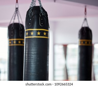 Heavy punch bags and equipment in the gym