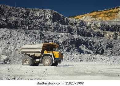 Heavy quarry truck in a limestone quarry, close-up.