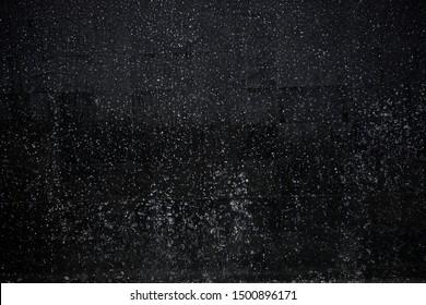 heavy rain against black night sky as background
