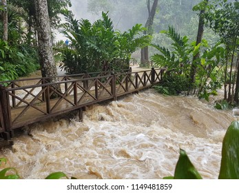 Heavy rain causes a lot of water at the waterfall in Laos. Tourists can not swim.