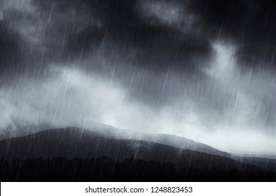 heavy rain landscape with hills and storm clouds