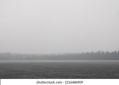 Heavy rain splashing in lake surface