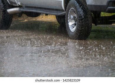 heavy rainfall and a pickup sitting in the rain