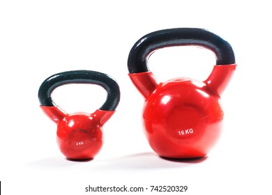 Heavy red training weights isolated on white background. Weight training equipment.