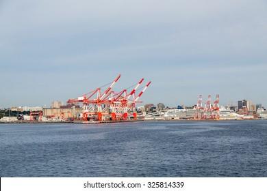 Heavy shipping cranes at a freight yard on the coast near Halifax, Nova Scotia, Canada