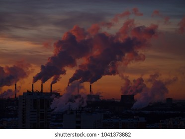 Heavy smoke discharged by industry polluting city air