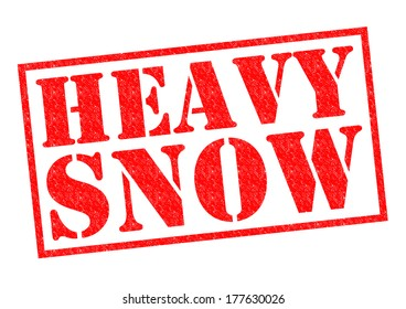 HEAVY SNOW red Rubber Stamp over a white background.
