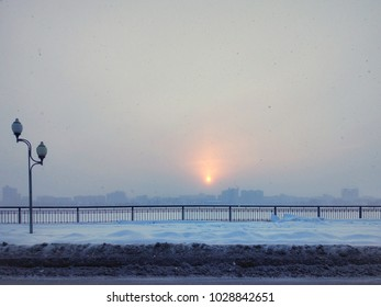 A heavy snowfall during the sunrise in Voronezh, Russia. The photograph shows large snowflakes in front of the lens.