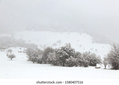 heavy snowfall in winter in a mountain valley
