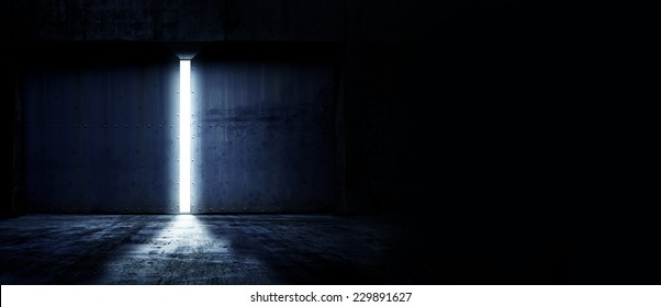 Heavy steel doors opening. Large steel doors of an hanger like building opening and light coming in. with copyspace