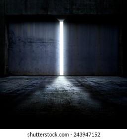 Heavy steel doors opening. Large steel doors of an hanger like building opening and light coming in.