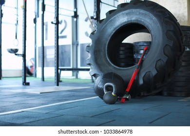 Heavy tire, hammer and kettlebell for training in gym