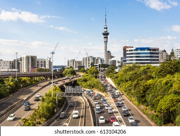 Heavy traffic along the spaghetti junction of various highways in Auckland, New Zealand largest city on a sunny day.