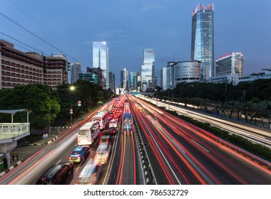 Heavy traffic during the rush hour on the Gatot Subroto highway in Jakarta business district at night in Indonesia capital city. The city is well known for its congestion problem