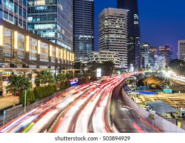 Heavy traffic in Jakarta business district along the city main avenue, Jalan Sudirman, at night in Indonesia capital city