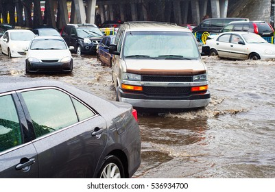 Heavy traffic on a flooded city road in the rain