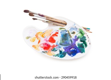 Heavy used artist's palette with brushes