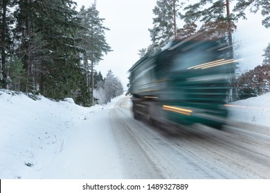 Heavy vehicle in blurred motion on icy winter road