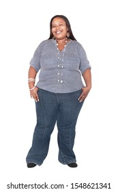 Heavy weight african woman dressed casual with jeans, isolated on white background