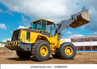 heavy wheel loader excavator machine loading sand at quarry