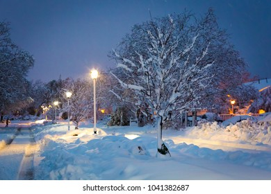 Heavy winter snow after storm at night with street lights