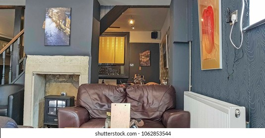 HEBDEN BRIDGE - APRIL 3, 2018: Interior of a coffee shop with leather sofas in Hebden Bridge, West Yorkshire, UK