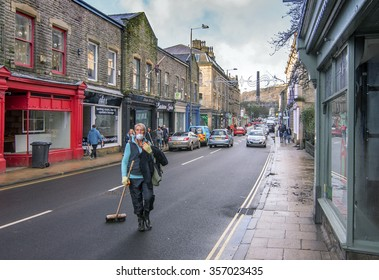 Hebden Bridge - DECEMBER 31: Local people clean up the aftermath of storm Eva after heavy rainfall created flooding and structural damage at the river Calder: December 31, 2015 in Hebden Bridge, UK.