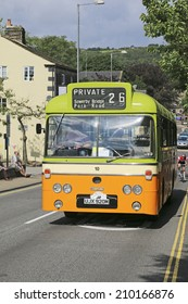 HEBDEN BRIDGE, WEST YORKSHIRE - AUGUST 2, 2014: Vintage commercial vehicle driving through Hebden Bridge which is taking part in the 46th Transpennine Commercial run from Manchester to Harrogate