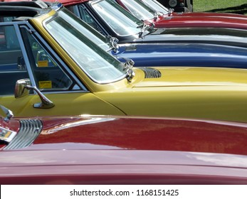 Hebden Bridge, West Yorkshire, England - August 4 2018: Close up of the bonnets and windscreens of a row of vintage triumph stag sports cars at hebden bridge vintage weekend public vehicle show