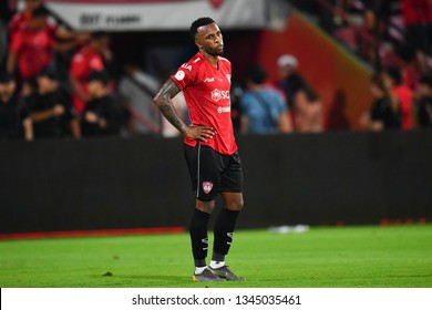 Heberty no.7 (red) of SCG Muangthong United in action during The Football Thai League match between SCG Muangthong United and PT Prachuap F.C.at SCG Stadium on February24,2019 in Nonthaburi, Thailand
