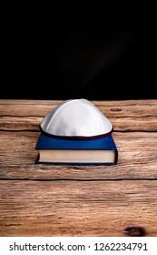 Hebrew Bible and skullcap.  Symbols of Jewish religion and culture.