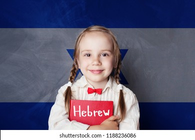 Hebrew concept with little girl student against the Israel flag background. Learn hebrew language