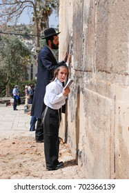 HEBRON, ISRAEL - APRIL 12, 2009: People pray next toTomb of the Patriarchs (Ma'arat HaMachpelah)  in Hebron