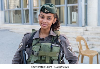 HEBRON, ISRAEL - NOVEMBER 02, 2018: Undefined beautiful israeli girl soldier next to Cave of Machpelah in Hebron or Tomb of the Patriarchs. Israel