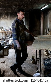 Hebron, Palestine, August 3, 2014: A Palestinian man works in a clay workshop which produces domestic utensils.